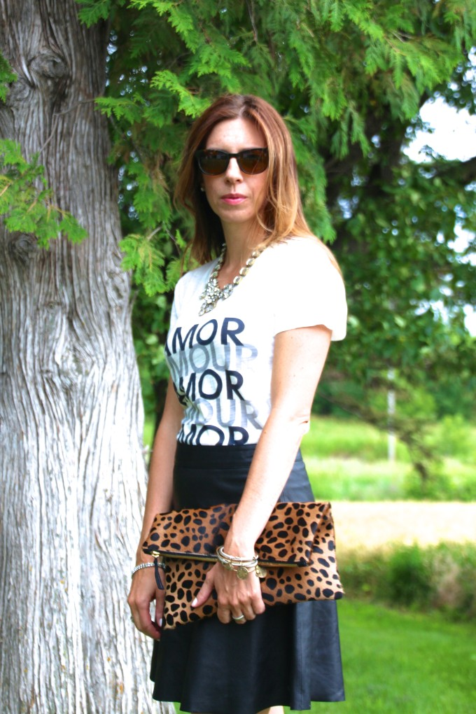 black leather skirt, amour, graphic tee, leopard clutch, warby parker, david yurman