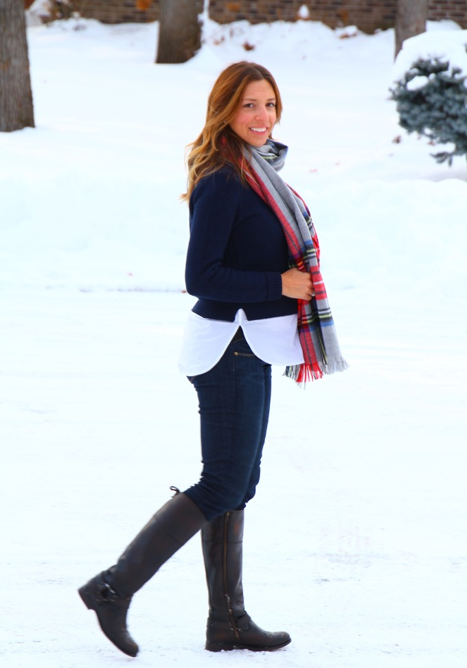 bundled up in layers of navy and riding boots