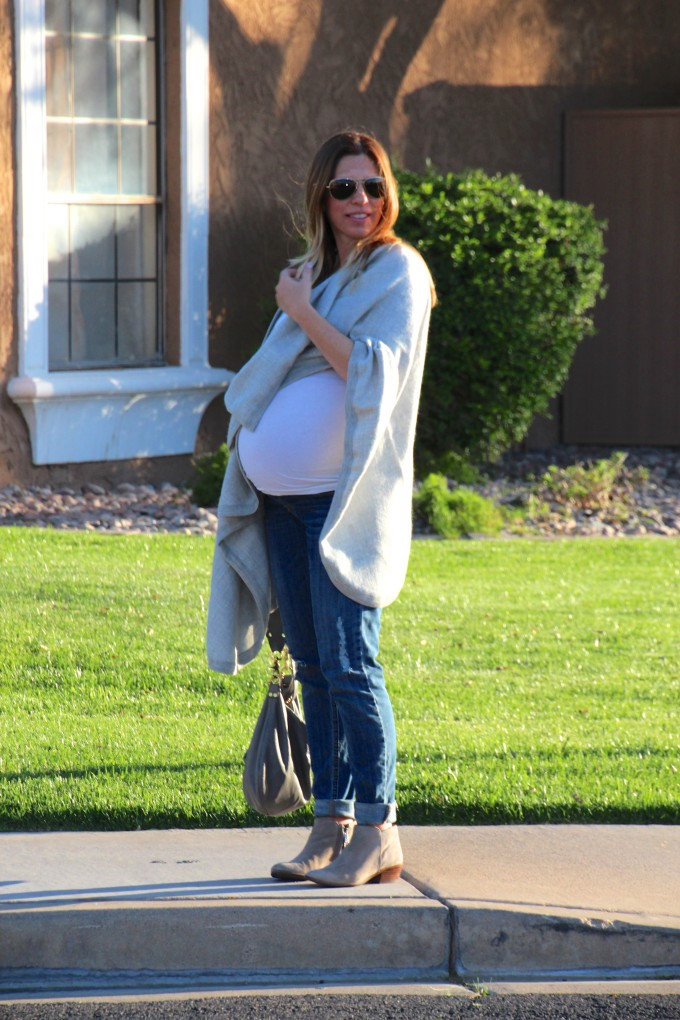 grey cuyana cape with a baby bump